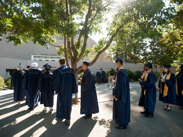 Students from Biological Sciences lined up outside of commencement ceremony